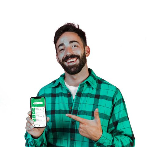 portrait photo of a smiling tradesman holding a mobile phone pointing to the screen which has the bidcrete mobile app running